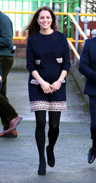 Kate Middleton visited the Barlby Primary School in London wearing a navy Madderson London maternity dress with a patterned tweed hem and pocket flaps.
