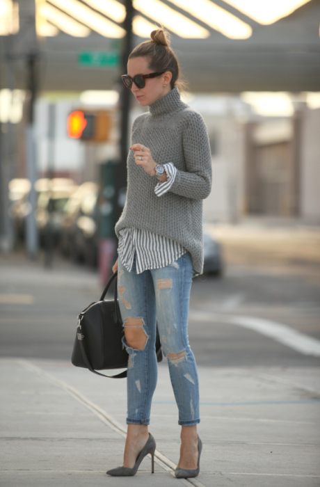 Magdalena Knitter wears a simple grey H&M knit with denim jeans and a stylish Celine handbag.