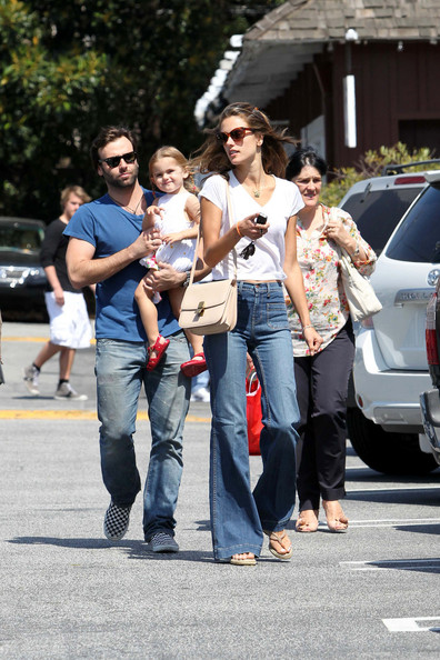 "Alessandra was spotted out in a pair of ""Bette"" high-rise wide leg jeans with her family."