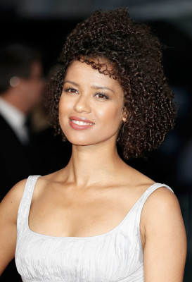 Gugu Mbatha-Raw wore her hair in tight curls at the BFI London Film Festival opening night gala.