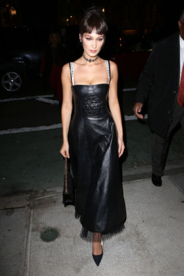 In a leather Dior Spring 2017 dress with a quilted bustier, Christian Dior straps and tulle hemline, pointed-toe pumps, chain strap handbag and jeweled choker while out in New York.