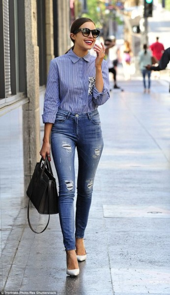 Olivia Culpo showcases slender frame in very tight high-waisted jeans