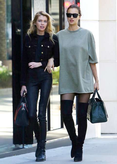During an outing with her pal Stella Maxwell, the expectant star turned heads in an oversize Yeezy tee, black suede over-the-knee boots, and cool shades.
