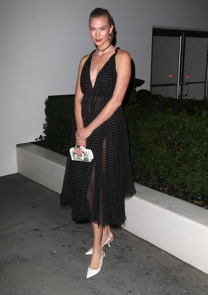 Karlie Kloss was equal parts sweet and sexy in a sheer dotted dress by Christian Dior at the 2016 Guggenheim International Gala.
