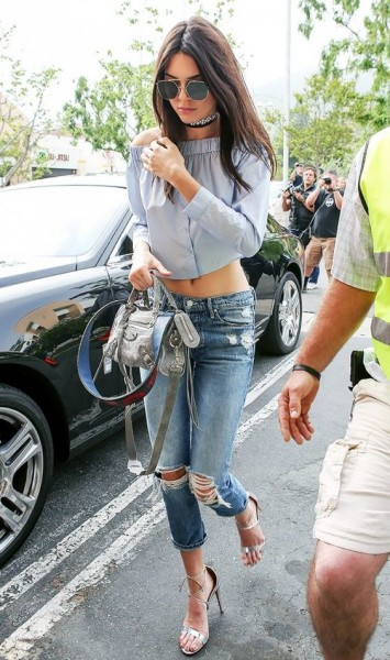 Kendall adds her own style to a basic off-the-shoulder top and distressed denim with a layered choker look.