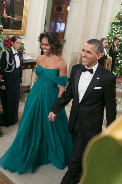 Michelle Obama chose a regal emerald-green off-the-shoulder gown by Marchesa for the Kennedy Center Honors Gala.