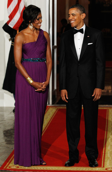 Michelle Obama looked every bit the glamorous diva in her plum-colored one-shoulder gown during a state dinner at the White House.
