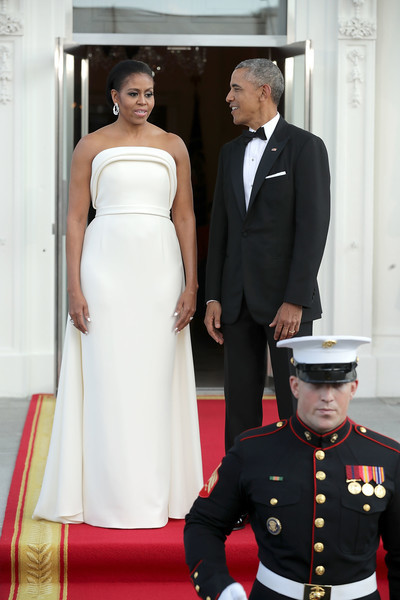 Michelle Obama looked impeccable in a white Brandon Maxwell gown, featuring a sleek, strapless silhouette and a layered neckline, during the state dinner for Singapore's Prime Minister.