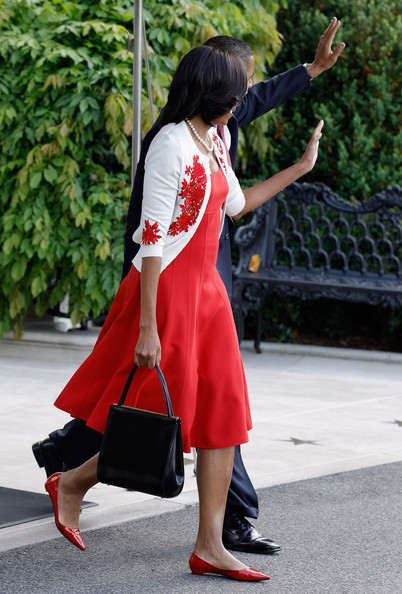 Michelle Obama paired red pointy flats with her dress for a retro finish.