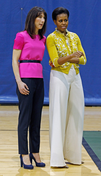 Michelle Obama paired white wide-leg pants with a yellow cardigan when she attended an Olympic-themed children's event.