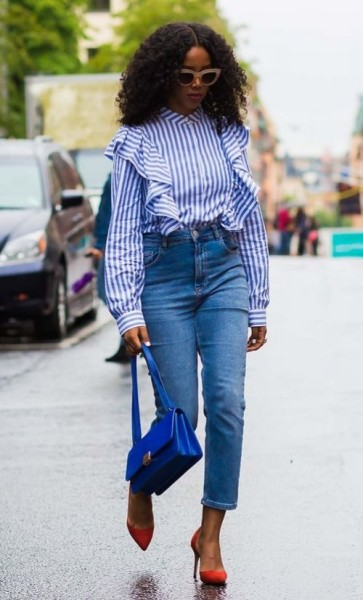 A blue and white striped ruffled shirt and high-waisted denim.
