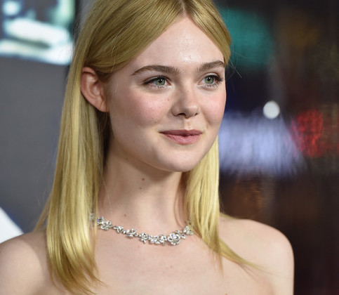 Elle Fanning was a natural beauty with her simple center-parted 'do and barely-there makeup at the LA premiere of 'Live by Night.'
