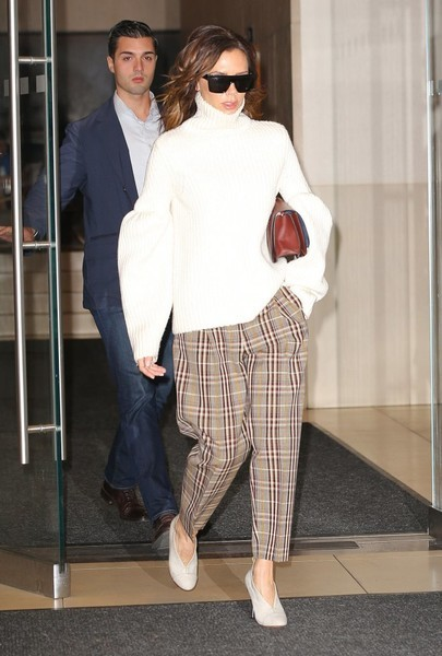 Victoria Beckham looked ready for freezing weather in a white turtleneck from her label, which she pulled all the way up to her chin, while out and about in New York City.