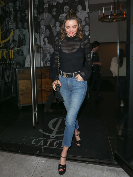 Miranda Kerr enjoyed a night out at Catch wearing a sheer striped top by Cinq a Sept.