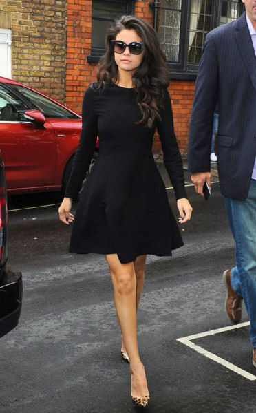 Selena tops off her fit-and-flare black frock with a sharp pair of Jimmy Choo sunglasses.
