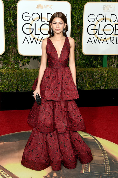Zendaya Coleman cut an ultra-feminine silhouette in a red Marchesa gown with a tiered skirt during the Golden Globes.