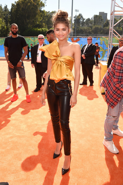Zendaya Coleman got flirty in a bow-adorned gold tube top by Moschino for the Kids' Choice Sports Awards.