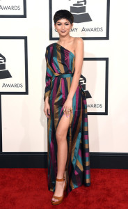 Zendaya Coleman sported a chic mix of colors in a striped, high-slit one-shoulder gown by Vivienne Westwood during the Grammys.