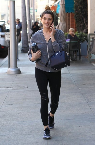 Ashley Greene accessorized with a mini leather bowler bag by Tory Burch.