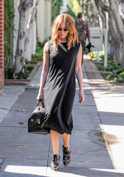 Ashley Tisdale styled her outfit with a black leather bowler bag by Louis Vuitton.