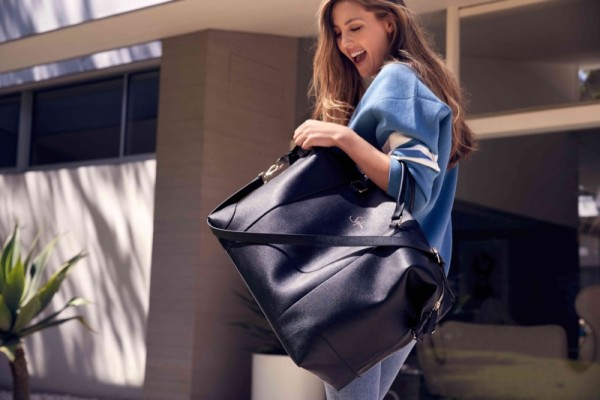 Sophia Stallone models a large tote bag in The Daily Edited campaign