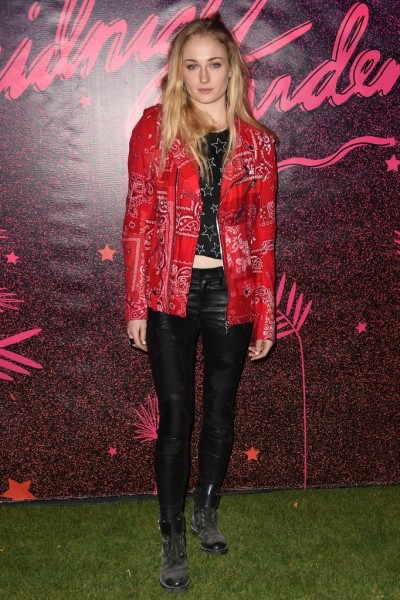 Sophie Turner wearing a bandana printed moto jacket