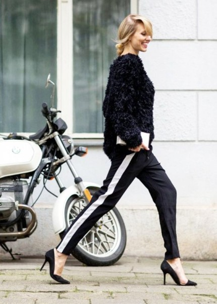 Dress up track pants with pointy-toe pumps