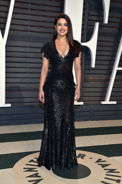 Priyanka Chopra chose a curve-hugging black sequin gown by Michael Kors for the Vanity Fair Oscar party.