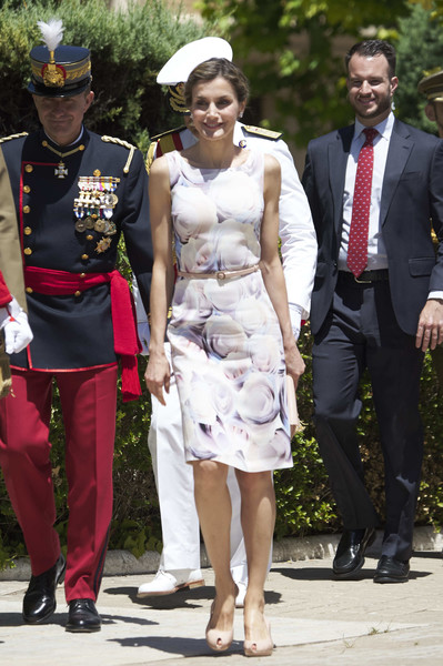 Queen Letizia of Spain charmed in a watercolor-print dress by Hugo Boss while attending a military event in Zaragoza.