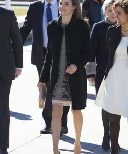 Queen Letizia of Spain headed to an International Congress wearing a classic black wool coat by Hugo Boss.