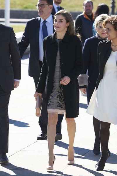 Queen Letizia of Spain headed to an International Congress wearing a classic black wool coat by Hugo Boss.