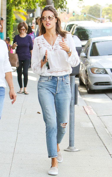 Alessandra Ambrosio sealed off her laid-back ensemble with a pair of Common Projects slip-ons.