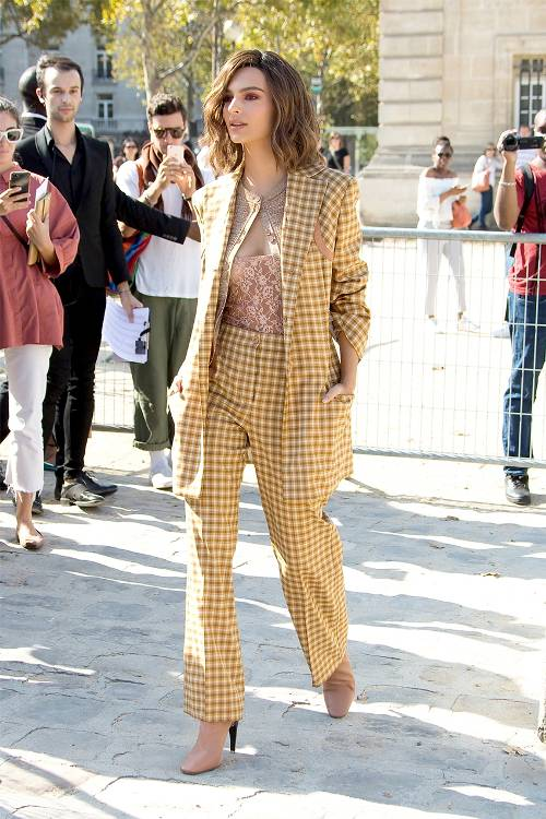 Emily Ratajkowski chose a gold checkered pantsuit by Nina Ricci for the label's Spring 2018 show. Brand: Nina Ricci