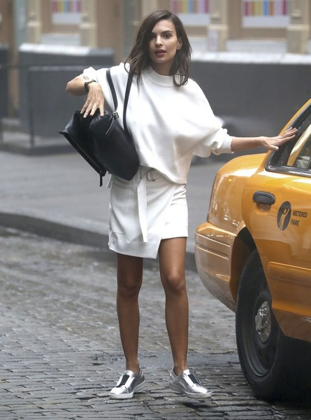 Emily Ratajkowski was sporty and stylish in a loose white sweater while doing a DKNY photoshoot.