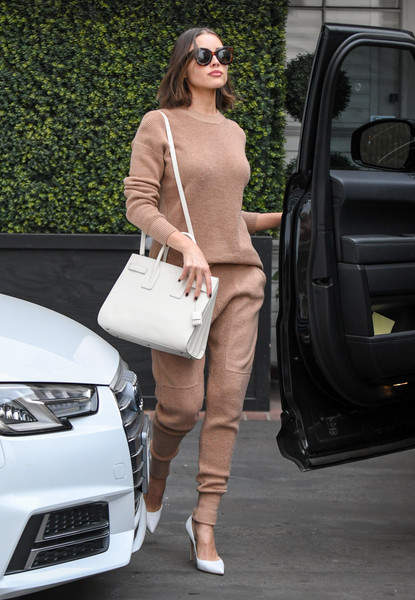 Olivia Culpo's arm candy for the day was a white Saint Laurent Sac De Jour.