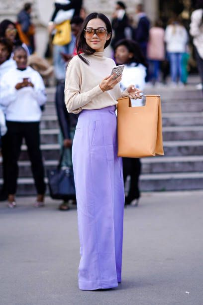 Yoyo Cao wears purple pants outside Elie Saab during Paris Fashion Week Womenswear Spring-Summer 2018