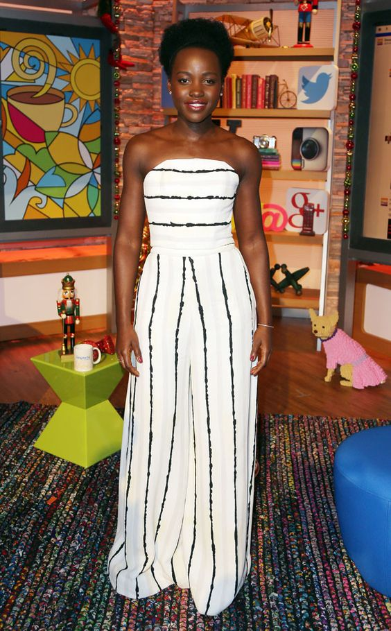 Lupita Nyong'o looking flawless in her striped ensemble while promoting The Force Awakens.