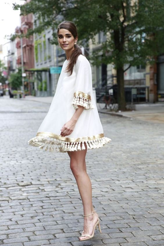 Formal Outfit with A white cocktail dress with tassels