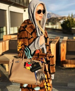 Chiara Ferragni in hooded sweater , Fendi coat, Hermes birkin and Karlito keychain !