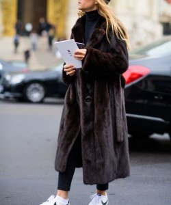 mira duma in athleisure and mink coat