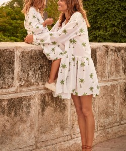 Andreea Diaconu poses in embroidered floral print dress from H&M