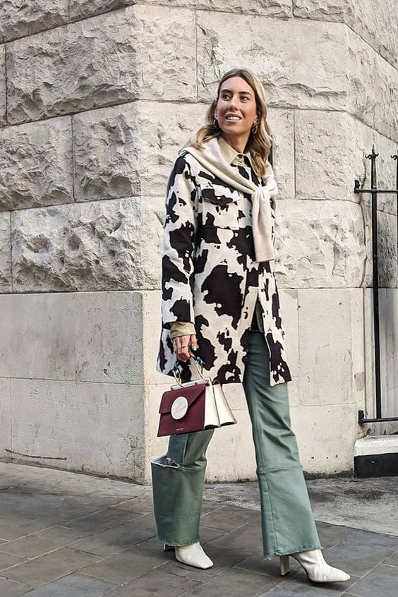 Hannah Lewis wearing a cow print coat