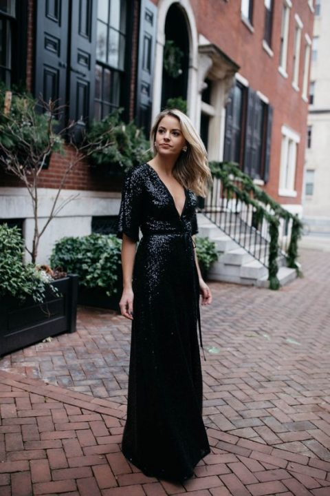 a black sequin wrap guest maxi dress with a deep V-neckline and short sleeves