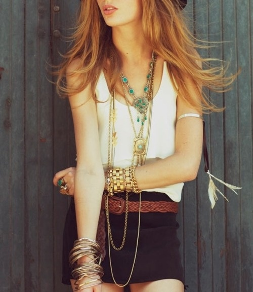 Layered necklaces and stacks of bracelets