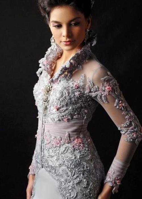 Modern Kebaya Kebaya, tradisional dress of java Indonesia. Kebaya usually worn with a sarong or batik kain panjang, or other traditional woven garment such as ikat, songket with a colorful motif.