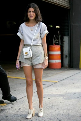 Leandra Medine rocks a structured leather style that may or may not be too diminutive to fit her phone. (But who cares when it's that chic?)