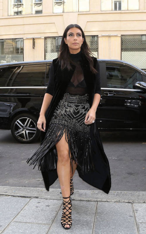 Kim arrives at the Balmain store