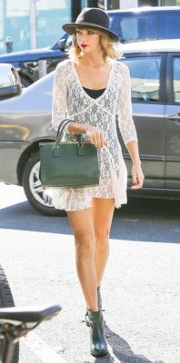 Taylor Swift in lace dress and ankle boots