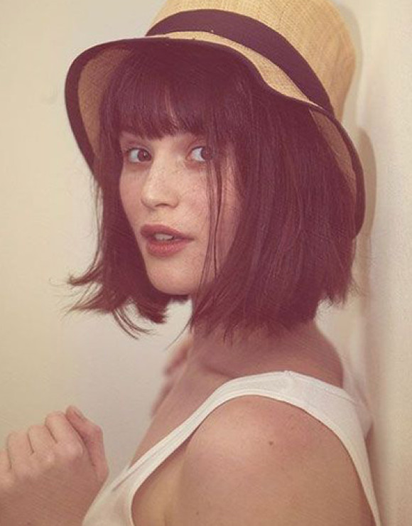 A blunt chin-length bob with full bangs