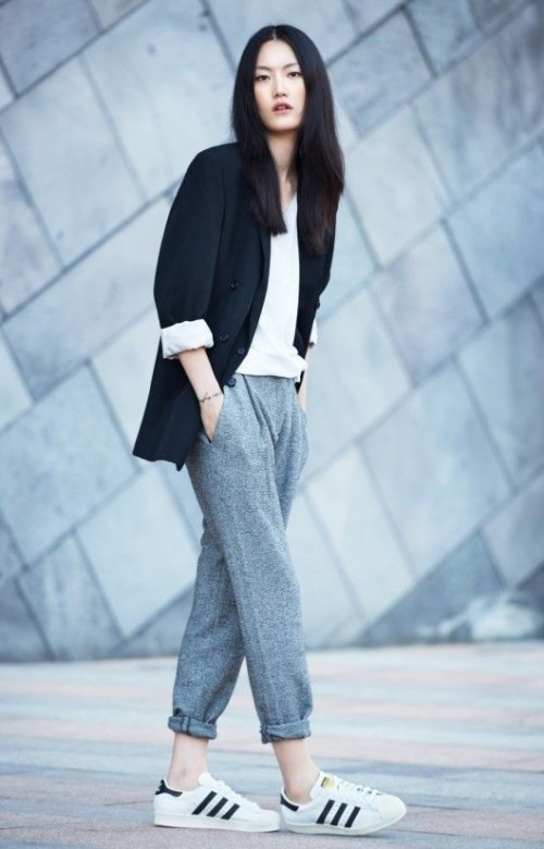 black blazer, white top, slouchy grey cuffed pants & Adidas sneakers